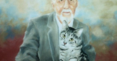 portrait of man holding cat