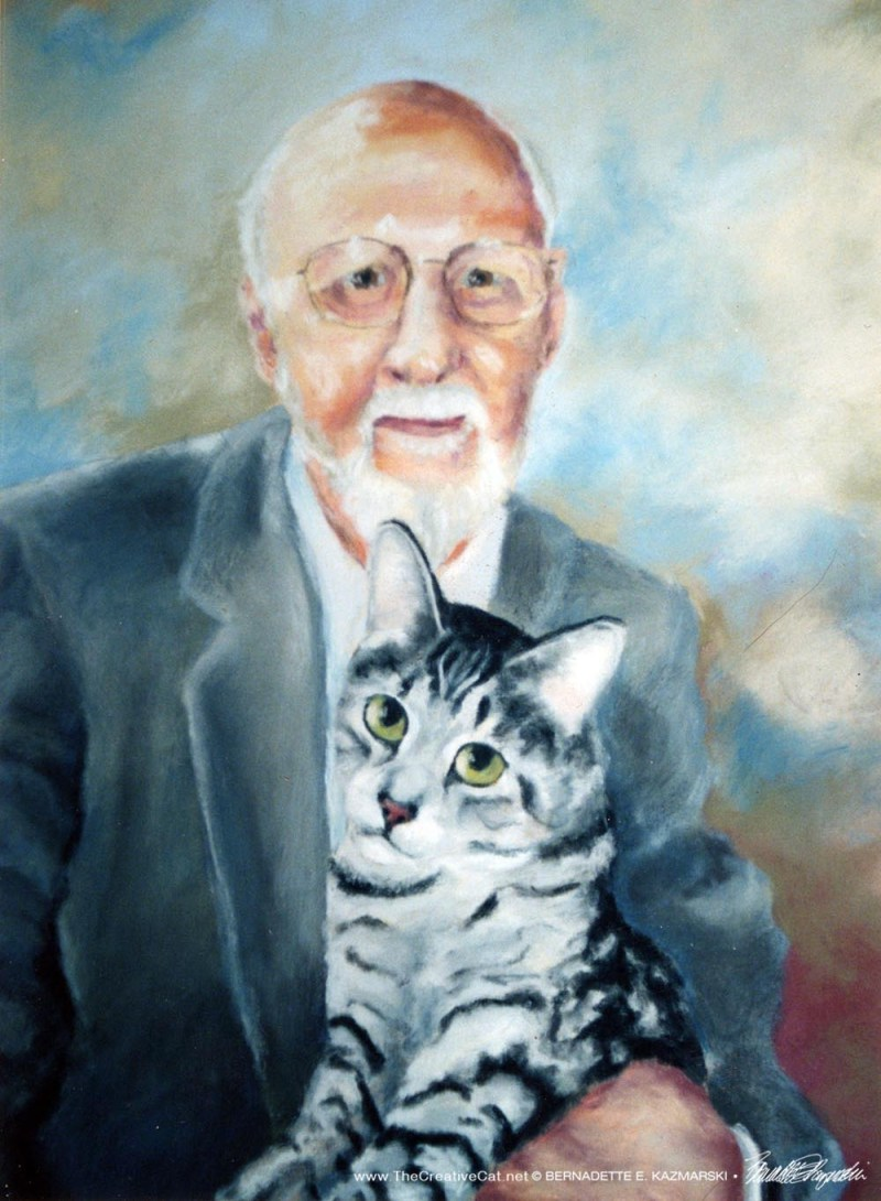 portrait of man holding cat