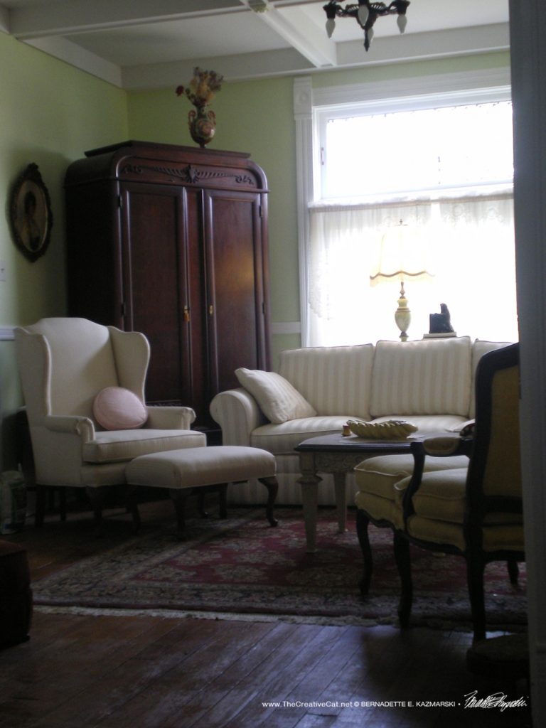 The living room with the armoire.