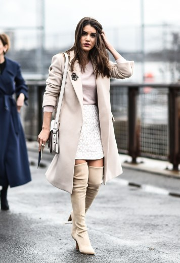 NEW YORK, NY - FEBRUARY 16: Camila Coelho is seen outside the Coach show wearing a Stella McCartney coat, Stuart Weitzman boots and a Coach bag during New York Fashion Week: Women's Fall/Winter 2016 on February 16, 2016 in New York City. (Photo by Daniel Zuchnik/Getty Images)