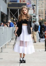 NEW YORK, NY - SEPTEMBER 13: Xenia Tchoumitcheva is seen outside the DVF show wearing YSL white sheer skirt, Dolce and Gabbana top, Hogan shoes and a Maria Lamanna black bag during New York Fashion Week 2016 on September 13, 2015 in New York City. (Photo by Daniel Zuchnik/Getty Images)