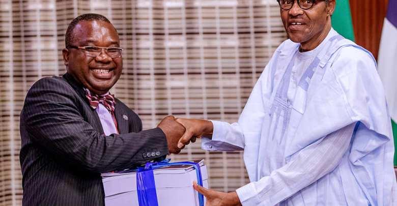 President Buhari receiving the report from the panel's chairman, Tony Ojukwu