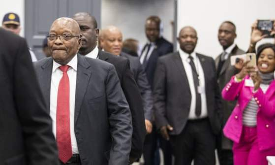 Zuma, in red tie, arrives the corruption inquiry