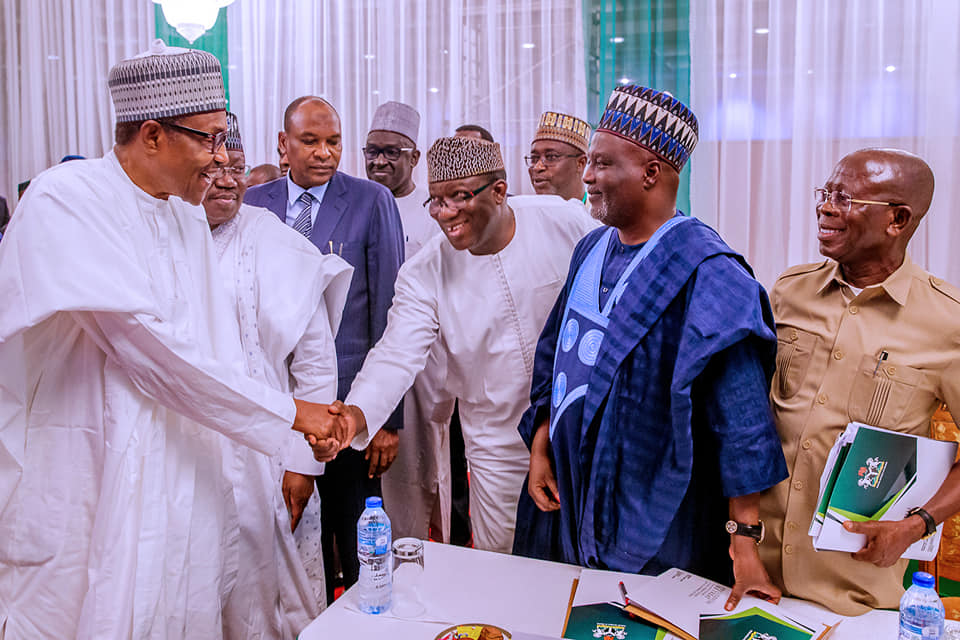 President Buhari in a handshake with Dr. Kayode Fayemi, Chairman of Nigerian Governors Forum