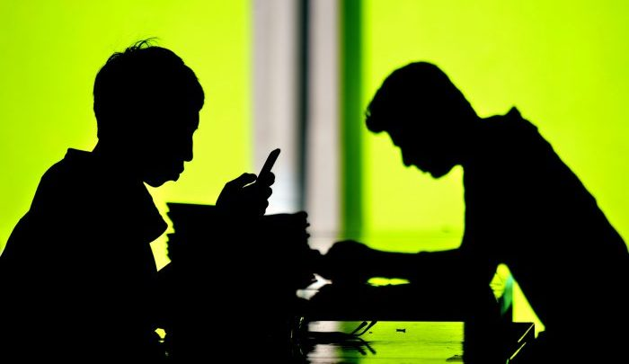 Silhouhette of journalists at work (Mage-Shutterstock)