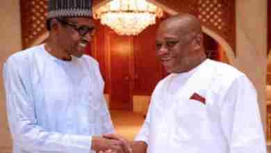 President Buhari in a warm handshake with Senator Orji Uzor Kalu