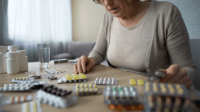 Grandma taking pills; lonely (photo-videoblocks.com)