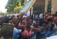 Topless women protesting outside the court premises (Photo-Sahara Reporters)