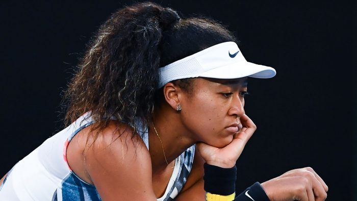 Naomi Osaka-deposed and distraught-Japan's Naomi Osaka reacts after a point against Coco Gauff of the US during their women's singles match on day five of the Australian Open tennis tournament in Melbourne on January 24, 2020. (Photo by William WEST / AFP) /