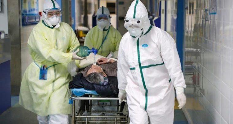 Coronavirus victim being taken away (Photo credit- Al-Jazeera)
