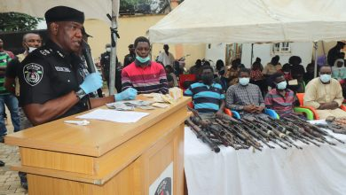 CP Frank Mba parading the suspects and their weapons on Monday