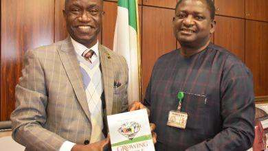 CIPM President, Mr Segun Mojeed, presents copy of his book to Mr. Femi Adesina