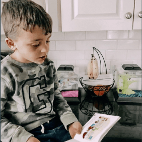 This is a photo I took of my nephew reading to his fish. He said he misses his friends at school.