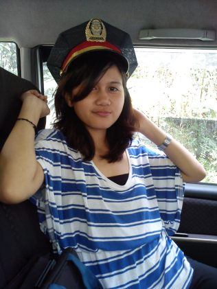 Xandy and I wearing kuya Niel's father's police hat that we found on the back seat.