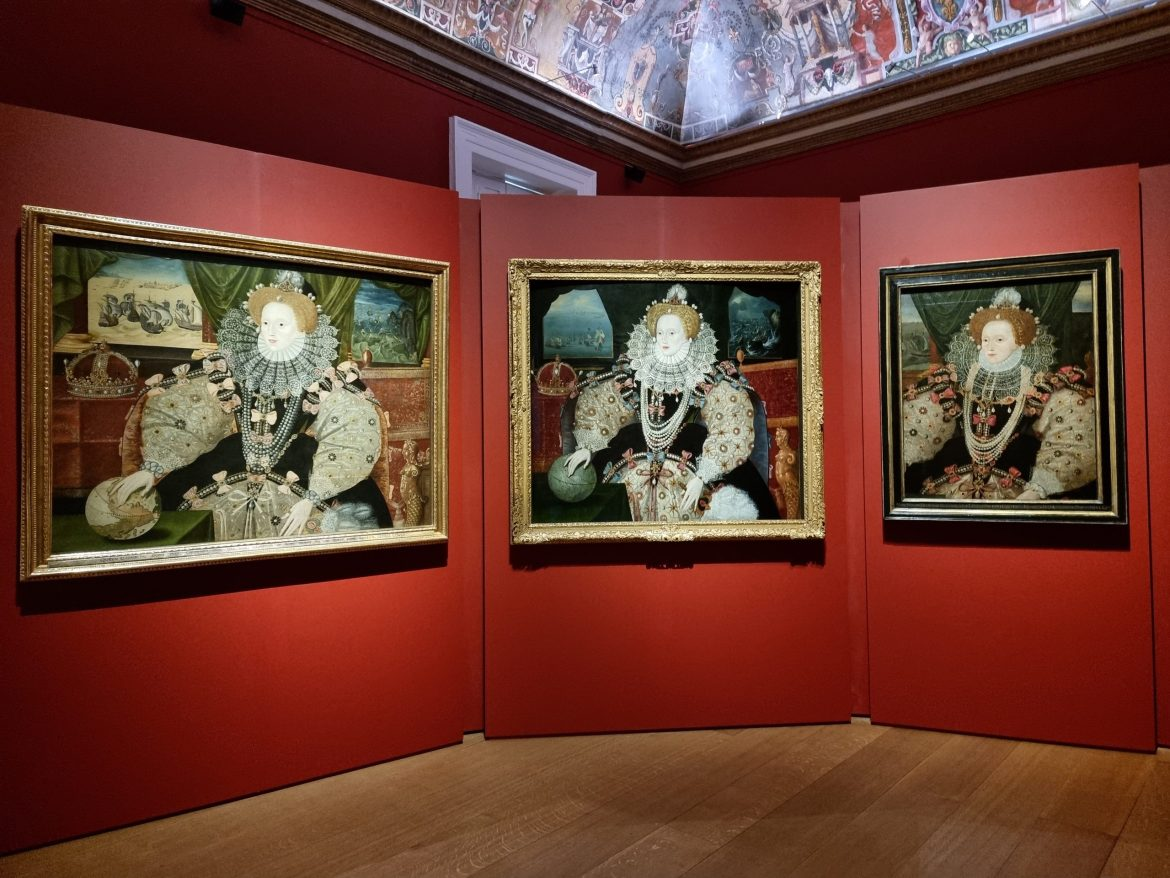 three portraits of Elizabeth I hung on red background. Elizabeth wears a lace ruff, and lots of pearsl, while her dress features bows. Her hand rests on a globe, with a crown next to her, and the Armada battle goes on in the background, seen through the windows