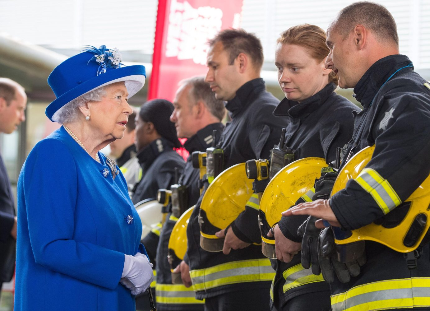 The Queen and Prince William meet firefighters during a visit to the Westway Sports Centre, London, which is providing temporary shelter for those who have been made homeless by the fire at Grenfell Tower. Picture by  i-Images / Pool)
