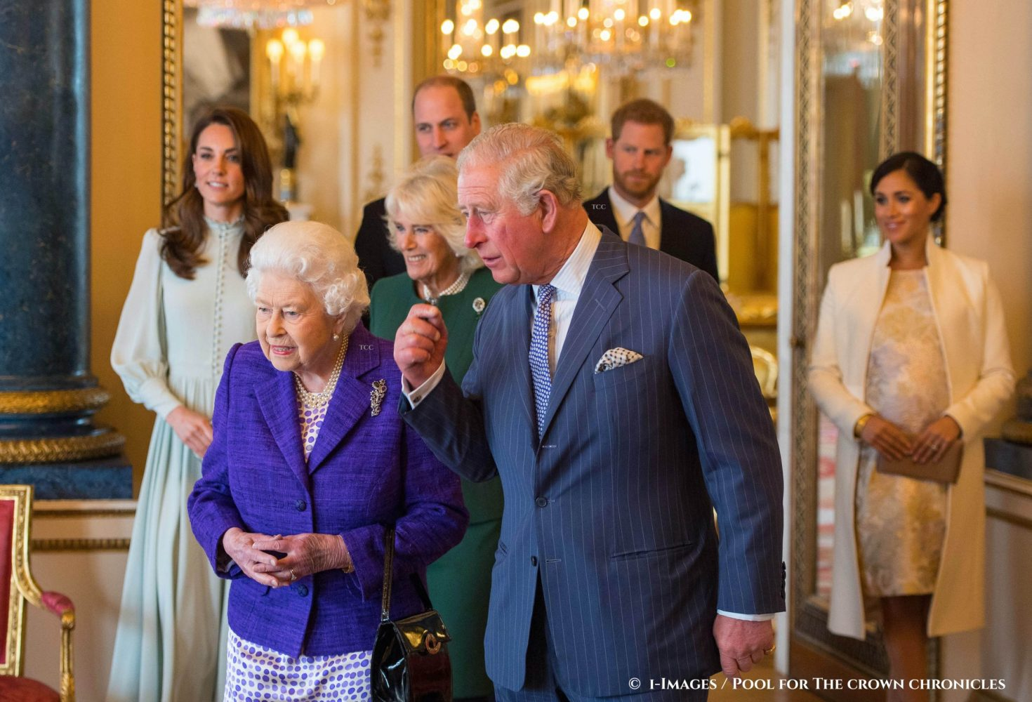 Image ©Licensed to i-Images Picture Agency. 05/03/2019. London, United Kingdom. Fiftieth anniversary of the Investiture of the Prince of Wales.   Queen Elizabeth II and the Prince of Wales, followed by the Duke and Duchess of Cambridge, the Duchess of Cornwall, and the Duke and Duchess of Sussex at a reception at Buckingham Palace in London to mark the fiftieth anniversary of the investiture of the Prince of Wales.   Picture by  i-Images / Pool