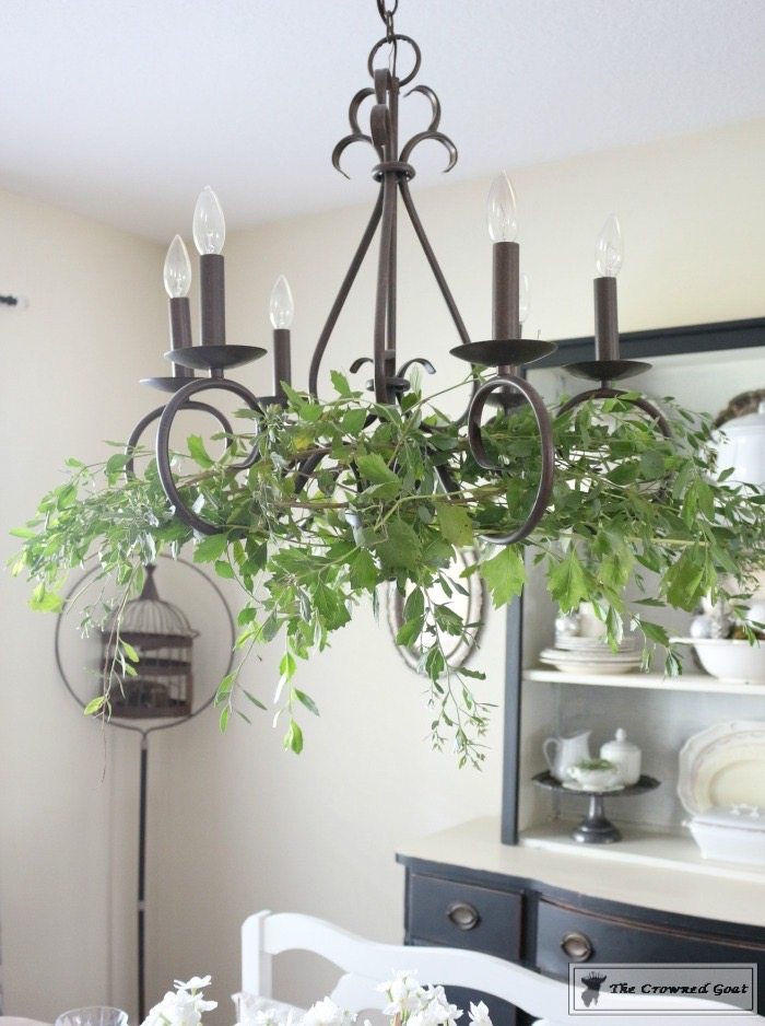 Simple-Holiday-Chandelier-with-Greenery-7 Adding Holiday Greenery to Simple Chandeliers Christmas DIY Holidays