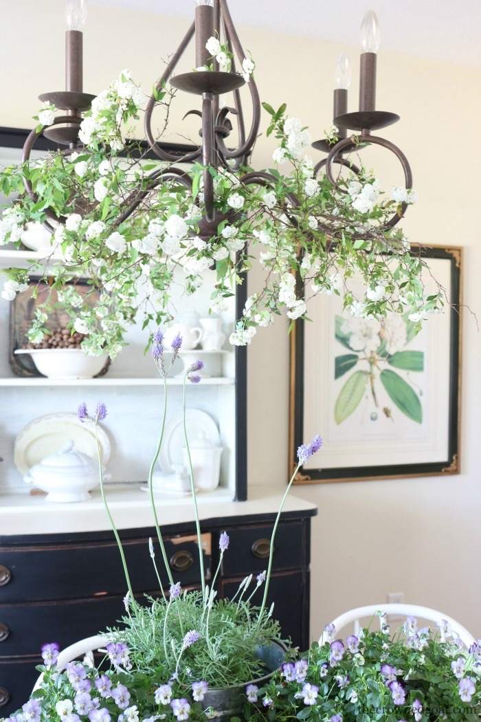 Adding-Spring-Greenery-to-Dining-Room-Chandelier-The-Crowned-Goat-7 How to Decorate a Chandelier with Flowers for Spring Decorating DIY Spring