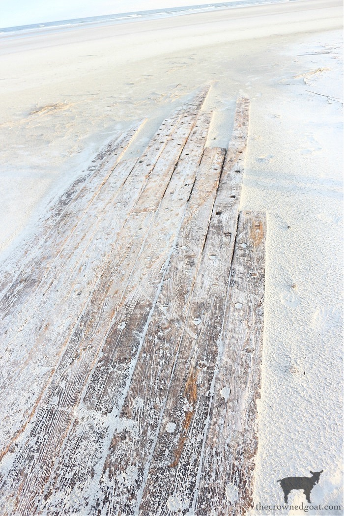 Wooden Boats Washed up on the Beach - The Crowned Goat