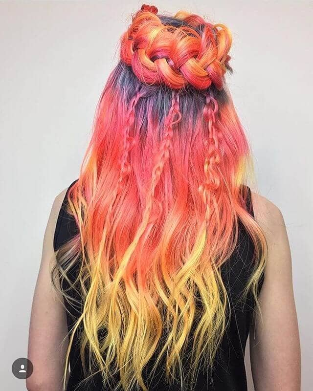Soft Sunset Hues with Purple Roots and Braids