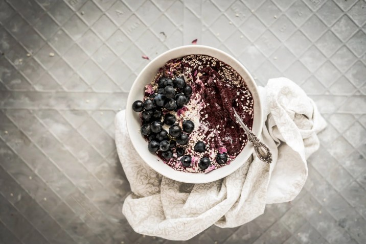 Purple Acai Smoothie Bowl on a gray background