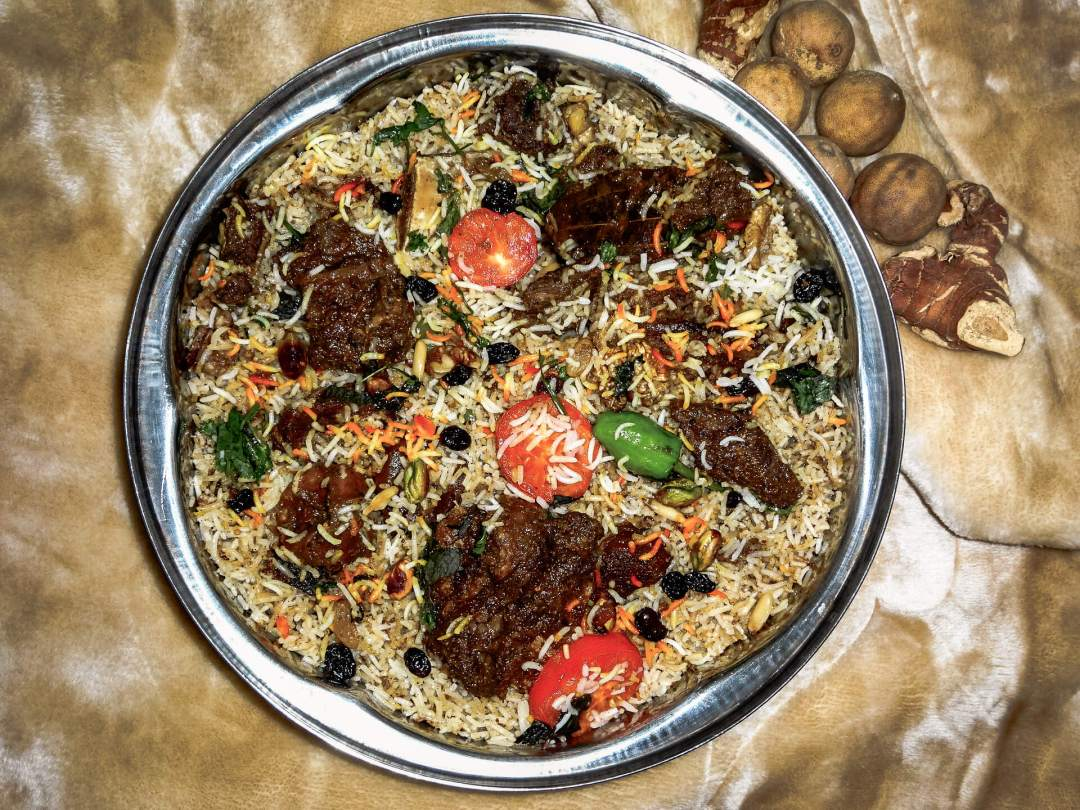 overhead photo of camel meat biryani in a dish