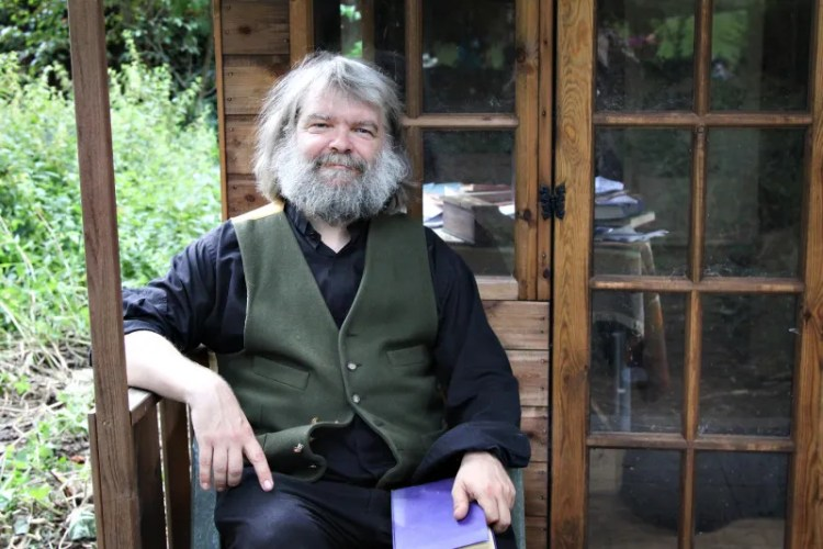 Malcolm Guite on the porch of the Temple of Peace - Image (c) Lancia E. Smith