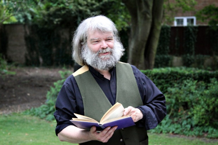 Malcolm Guite reading poetry to guests at the vicarage - Image (c) Lancia E. Smith