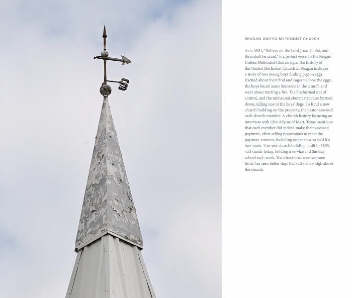 a weathered white church steeple with a weather vane on top