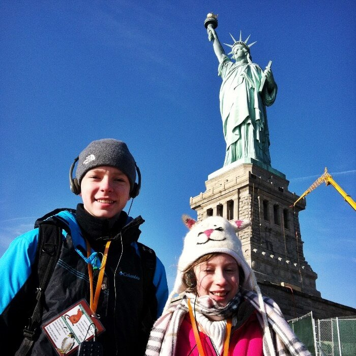 The Statue of Liberty with kids in front