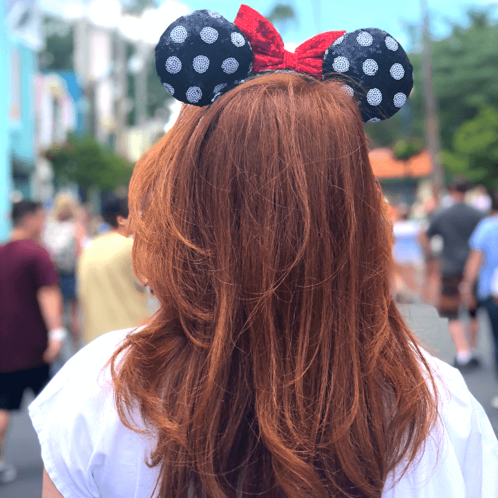 Red Headed Woman wearing Minnie Mouse Ears
