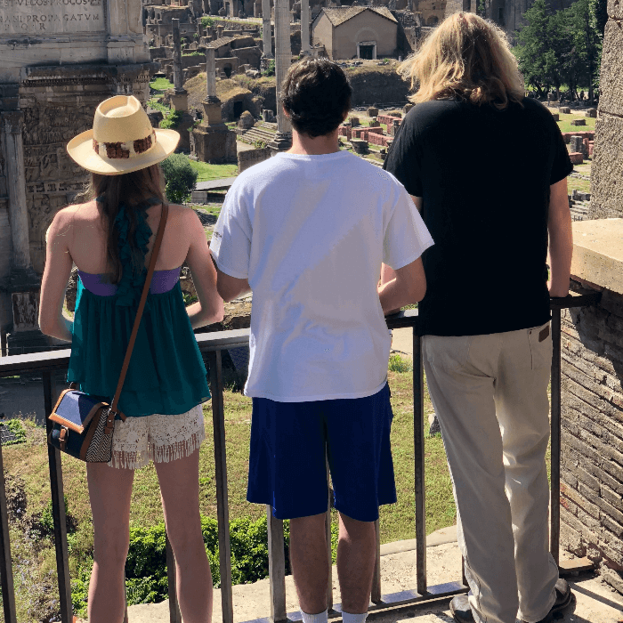 3 Teenagers looking out over the Roman Forum