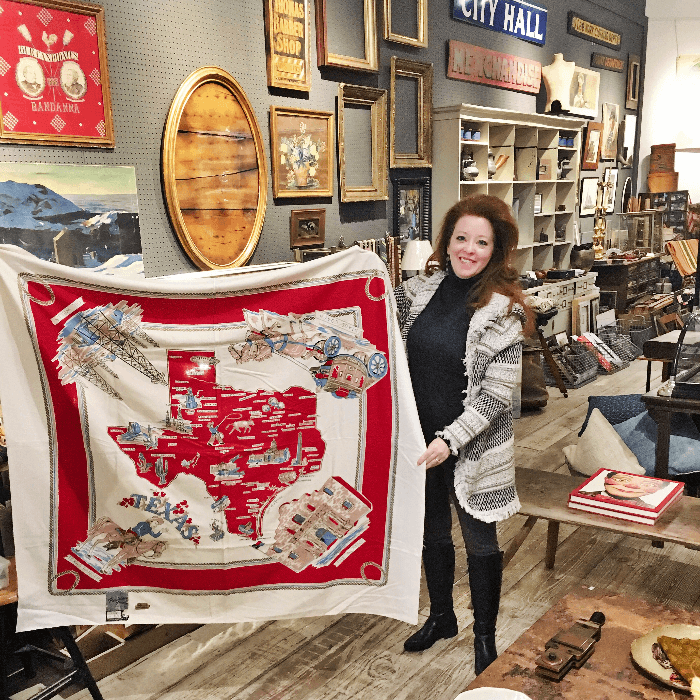 The Curious Cowgirl holding a large Vintage Texas Tablecloth