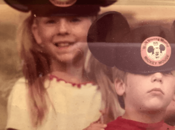 Vintage photo of The Curious Cowgirl and her brother wearing Mickey Mouse ears