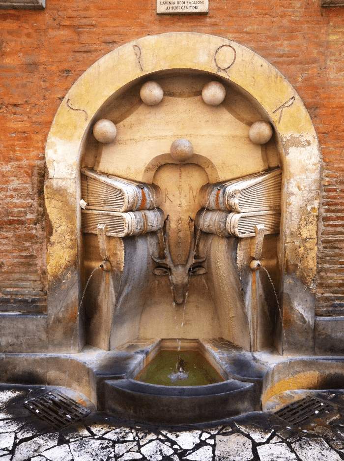 Water Fountain in Rome with carved books