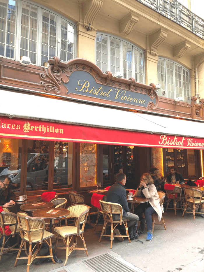 Red Awning and Tables and Chairs outside the Bistrot Vivienne