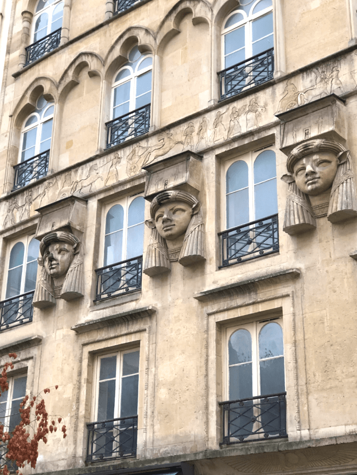 Egyptian Decorative Face Carvings on the exterior wall of the Passage Caire