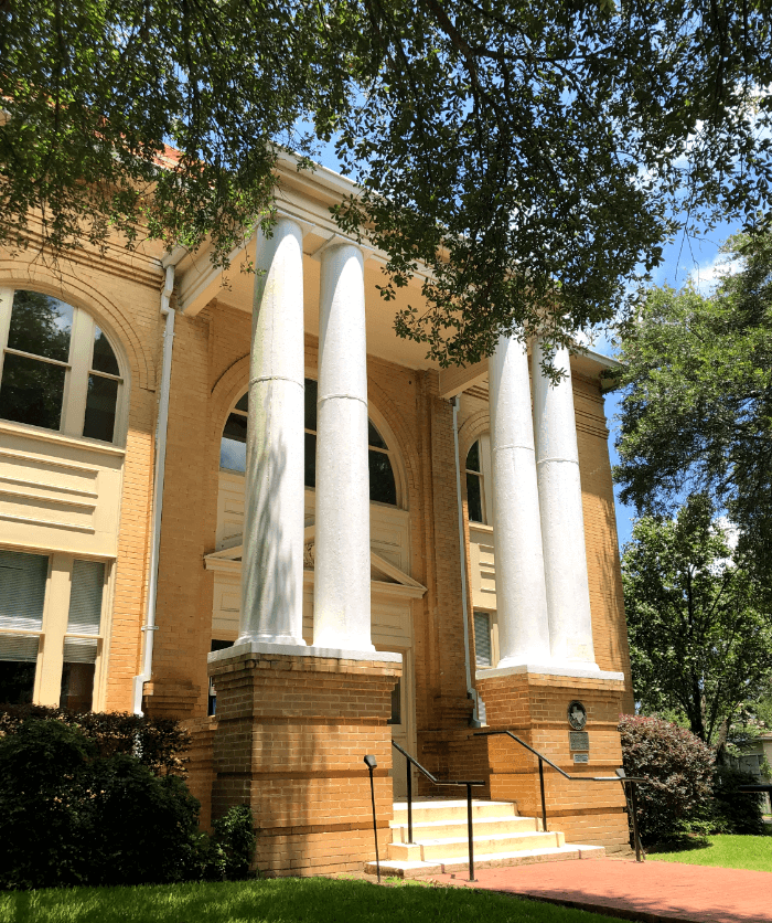 Tall white Columns on the front of a historic building