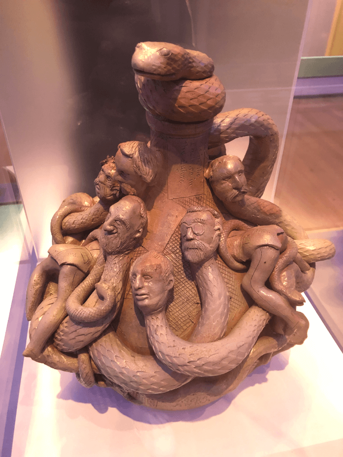 Jug decorated with snakes with the heads of men