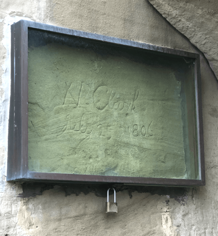 Metal box on a wall protecting a signature in Pompeys Pillar in Southeast Montana