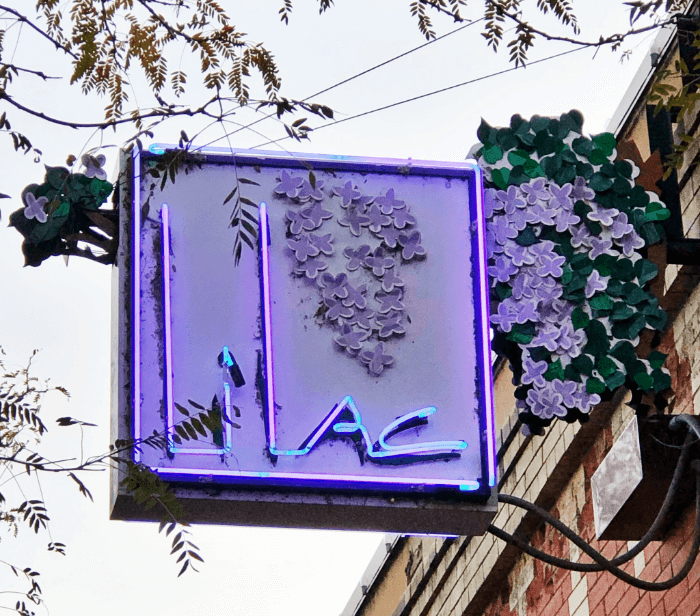 Purple neon Lilac Restaurant sign in southeast montana