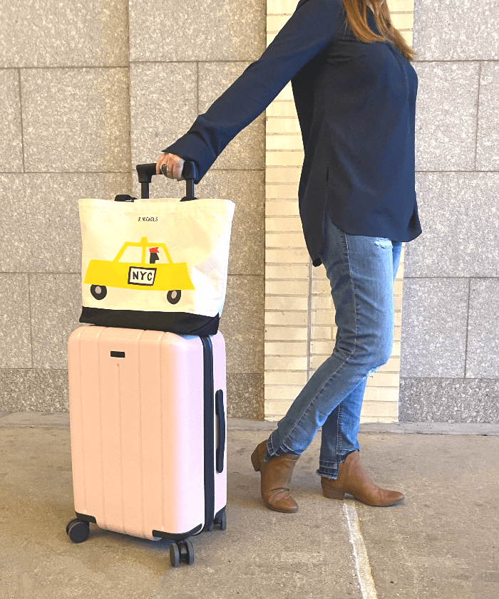 a pink carry on suitcase