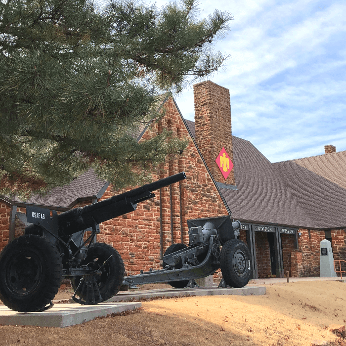 red brick building with armored vehicles in front