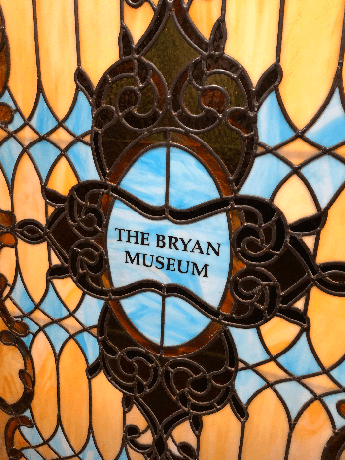 yellow and blue stained glass at the Bryan Museum