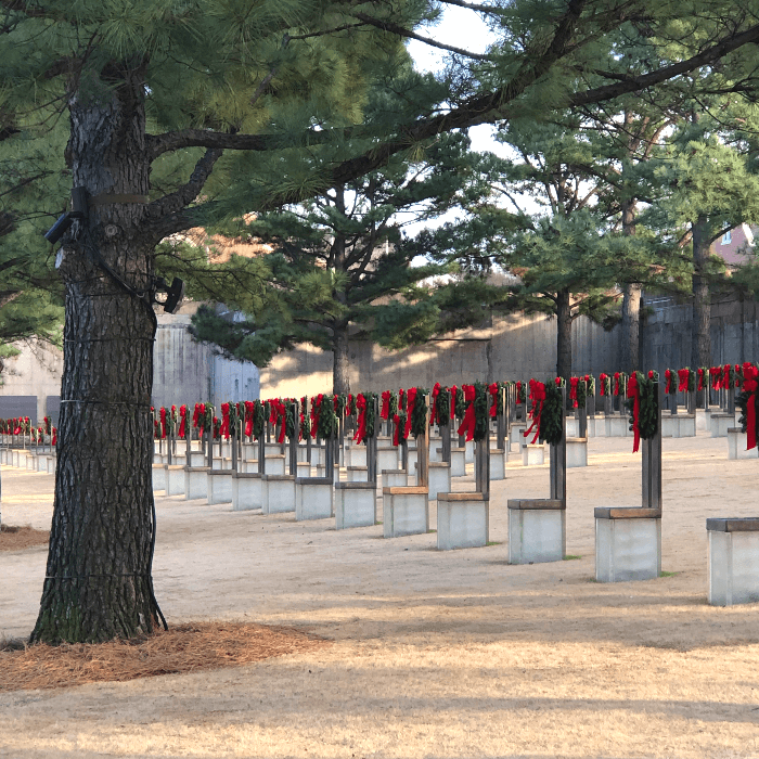 rows of chairs with Christmas wreaths at the Oklahoma city National Memorial