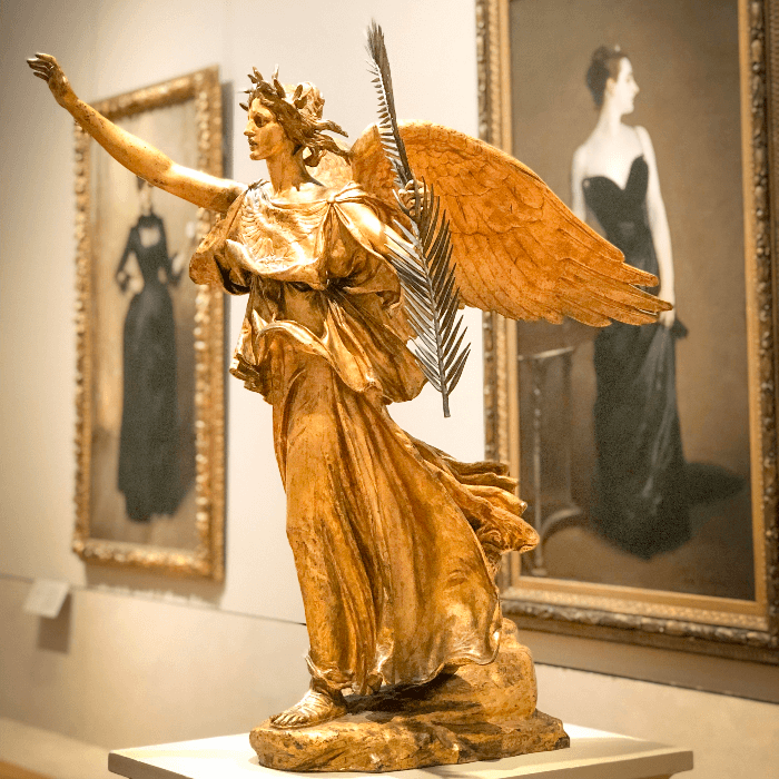 golden statue of an angel inside the Metropolitan Museum of Art