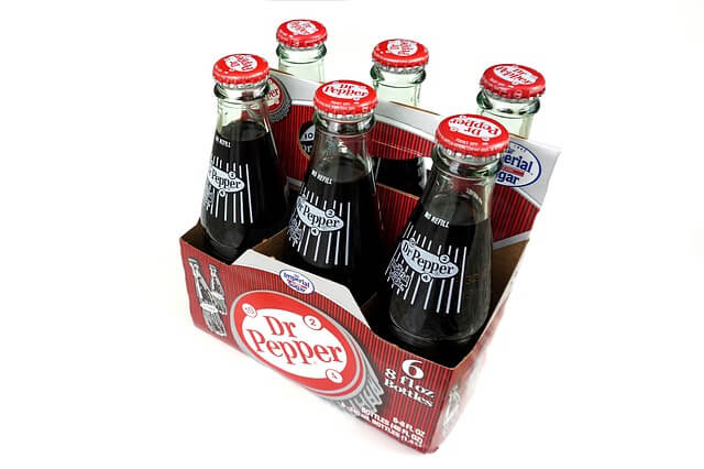a six pack of Dr. Pepper bottles