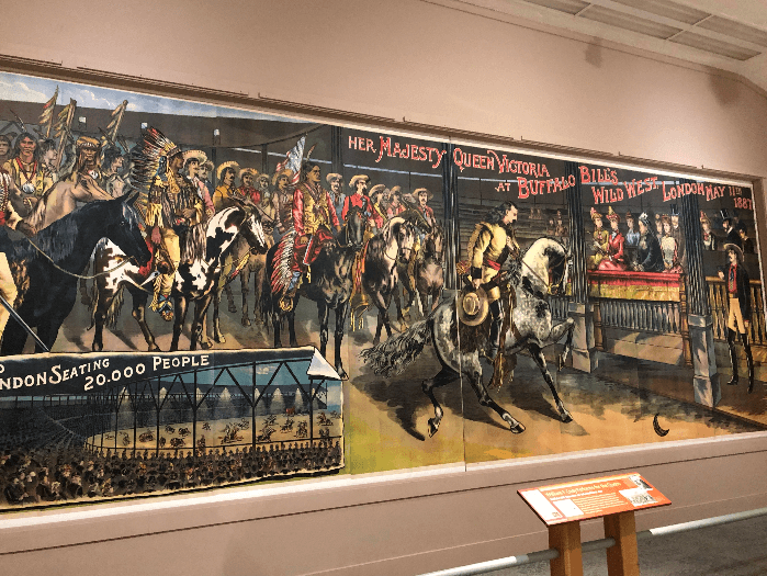 a long wall size poster with cowboys and Indians