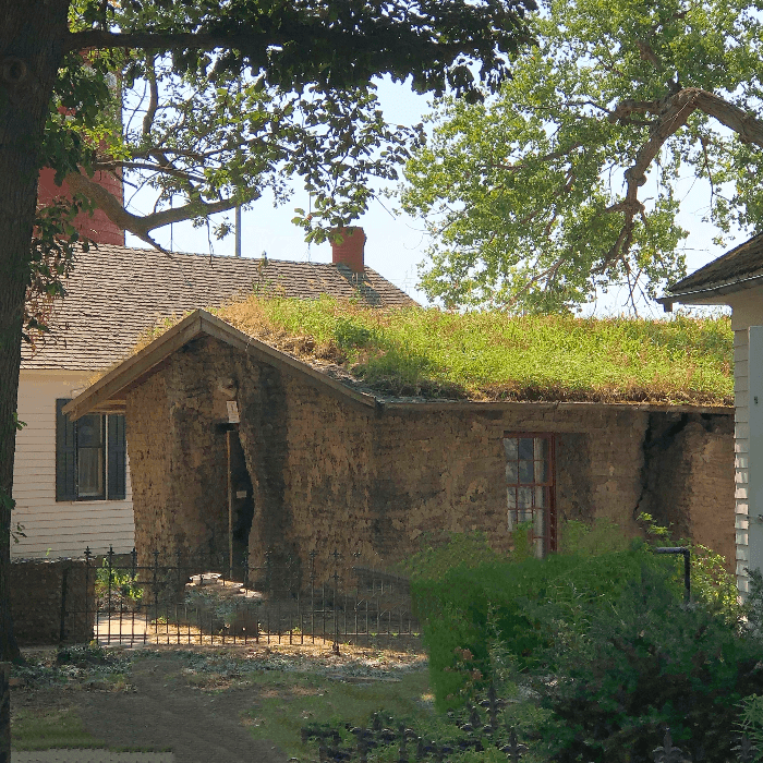 a stone house with a grass roof